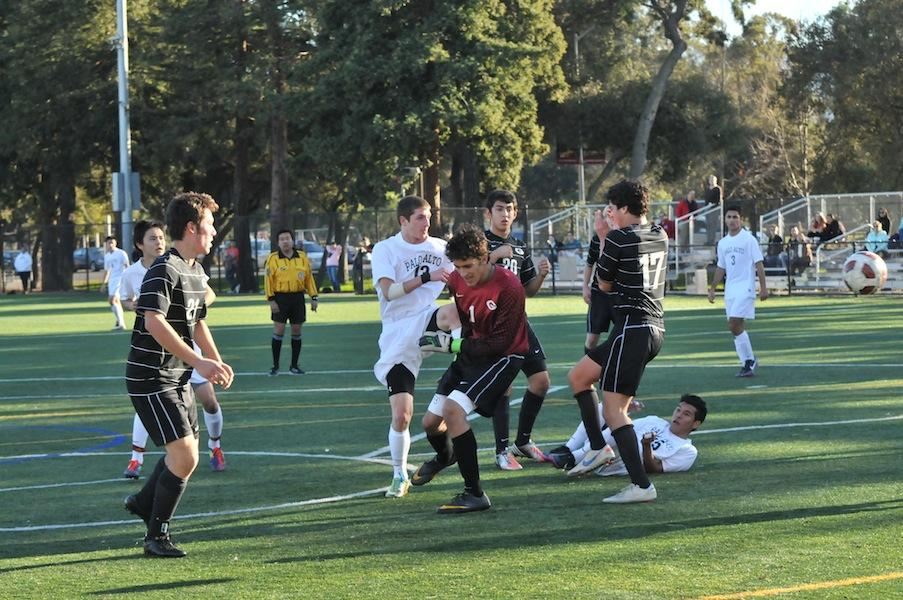 Midfielder Paul Stefanski ('13) scrambles a few Titans to get the ball into Viking possession. The Vikings went on to defeat the Titans with a score of 2-0.