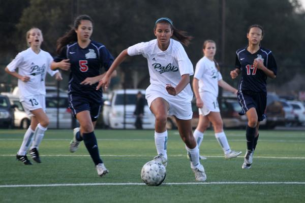 Alyssa Maharaj ('14) dribbles past Lynbrook defenders before taking a shot. The Vikings went on to win 4-0 and stay undefeated in league play.