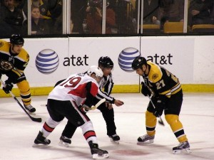 Jason Spezza (left) and Steve Begin (right) face-off during the regular season exhibition game between the Ottawa Senators and the Boston Bruins.