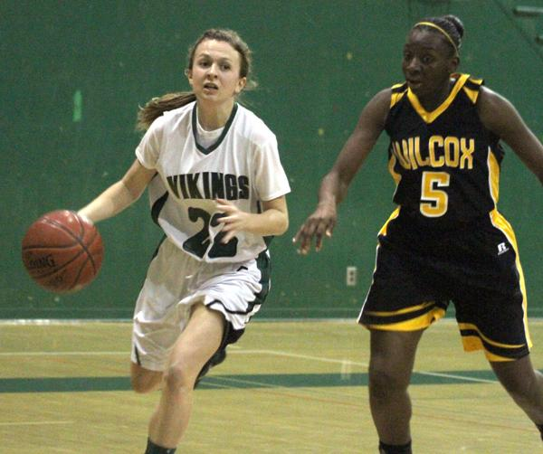 Atwater ('16) drives past Wilcox's Jessica King ('14). Atwater hit two free throws with time expired, to give the Vikings the win.