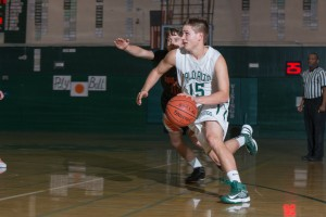 Mathias Schmutz ('13) drives by a defender during Paly's victory over Los Gatos on Feb. 8. Paly will play Riordan in the first round of CCS this Friday.