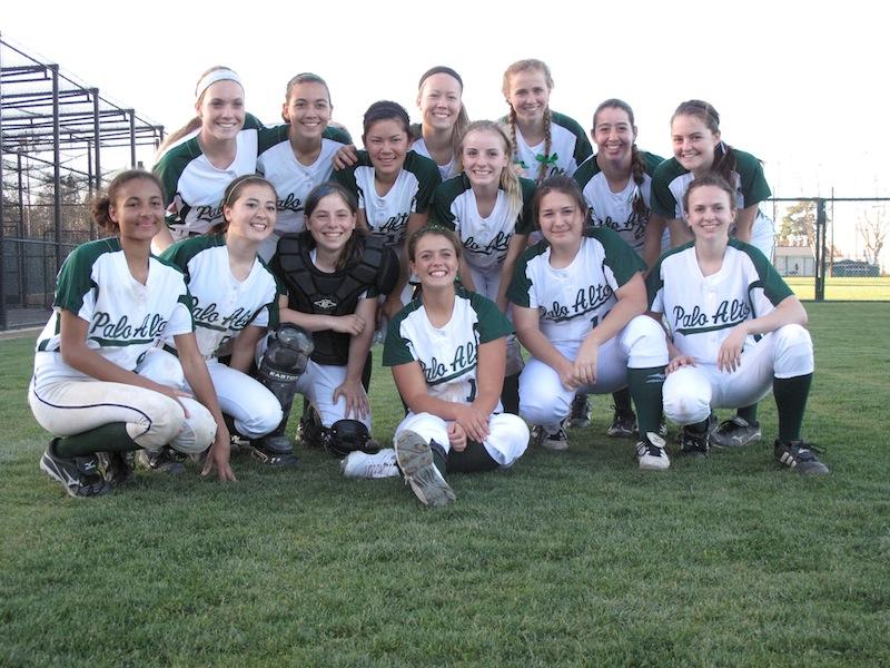 After+defeating+the+Burlingame+High+School+panthers%2C+the+varsity+softball+team+poses+for+a+picture+with+smiles+on+their+faces.+The+team+shut+down+the+panthers+6-3+with+exceptional+pitching+from+Julia+Saul+and+Casey+Glassford.