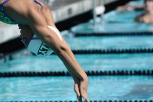 Katrina Nguyen ('14) dives into the water in one the team's 2012 meets. Now bigger and taller, she will remain an important asset as an anchoring sprint freestyler.