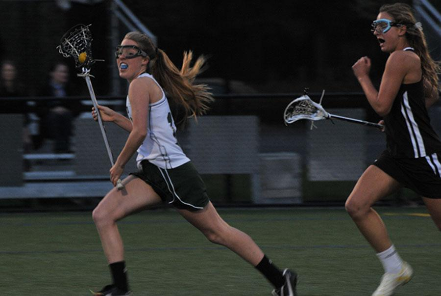 Allie+Peery+sprints+and+dodges+past+a+Pioneer+midfielder+on+Tuesday+night.+The+Vikings+went+on+to+win+the+game+16-3+to+keep+their+undefeated+record.