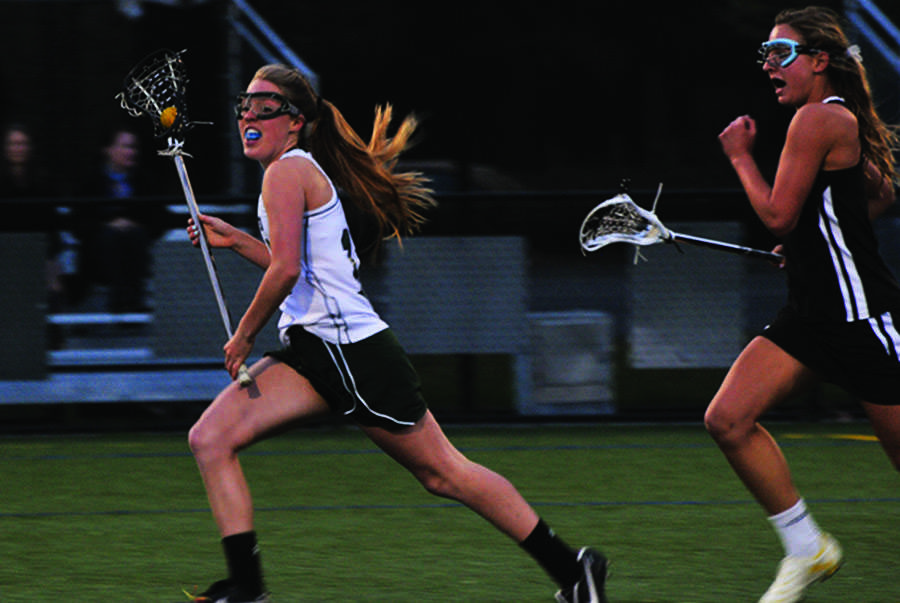 Allie Peery sprints and dodges past a Pioneer midfielder on Tuesday night. The Vikings went on to win the game 16-3 to keep their undefeated record.