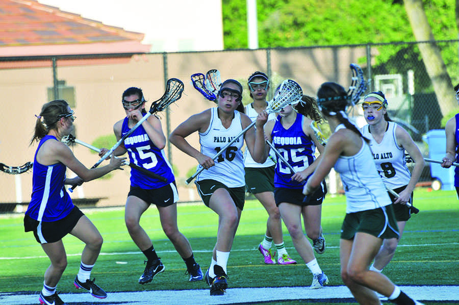 Headed towards the goal, Alanna Mitchell ('13) breaks through a wall of Sequoia defenders. The Vikings went on to crush the Ravens 18-1.