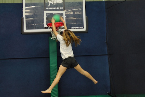 After several bounces, Ami Drez ('14) jumps for the hoop to dunk. After a few attempts at the basketball hoop, Drez felt it was too repetitive.