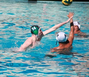 Kian McHugh ('14) applies strong defense against a Mitty player in the Vikings' 25-13 victory over the Monarchs.