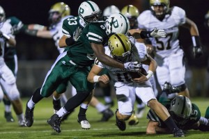De'Antay Williams ('13) and Erik Anderson ('13) tackle an Archbishop Mitty Monarch in game last year. These two graduated seniors make up the group of 16 whose gaps the Vikings look to fill in the 2013 season.