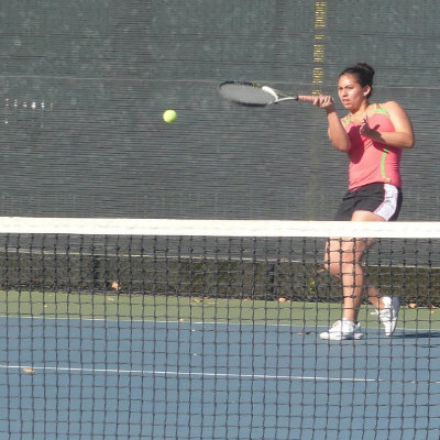 Elena Chavez ('14) returns a serve during practice as her team prepares for the Santa Catalina Invitational Tournament.