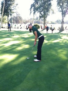 Michelle Xie ('15) putts during practice.  Xie is one of the two captains of the team this year.