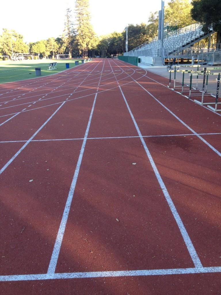 One+of+the+straightaways+on+the+Paly+track+sits+unused+late+in+the+day.+During+the+summer%2C+workers+resurfaced+the+track+and+finished+jump+pits%2C+completing+the+football+stadium+remodel.