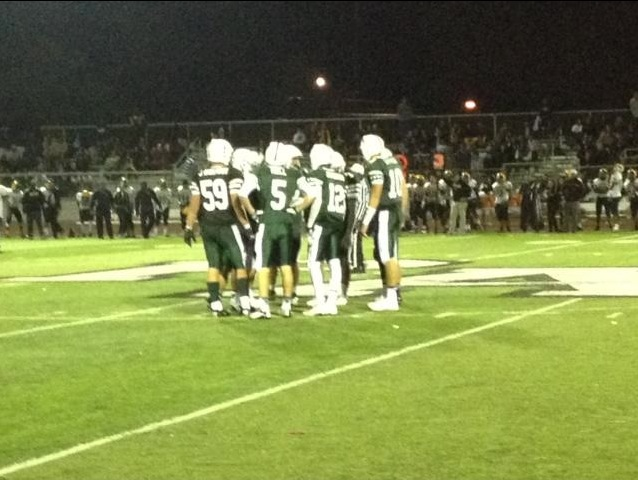 Paly+players+huddle+during+the+third+quarter+to+discuss+plays.+The+Vikings+came+up+short+to+the+Milpitas+Trojans%2C+losing+31-28.