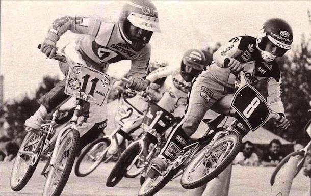 Craig Bark (number 11) races alongside Mike Miranda in 1982. Bark raced bicycle motocross for four years, traveling across the country and internationally for competitions.