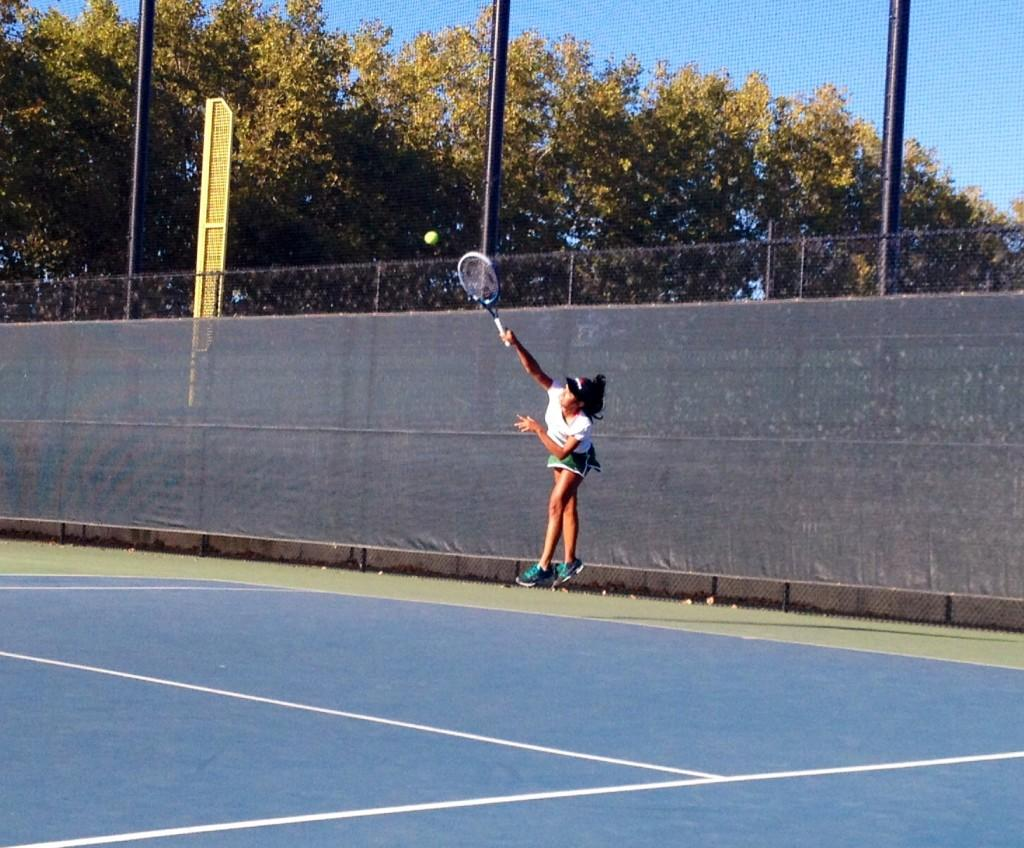 Aashli Budhiraja ('14) serves the ball in the first set of her match. She goes on to win the set in a tie-breaker, 7-6.