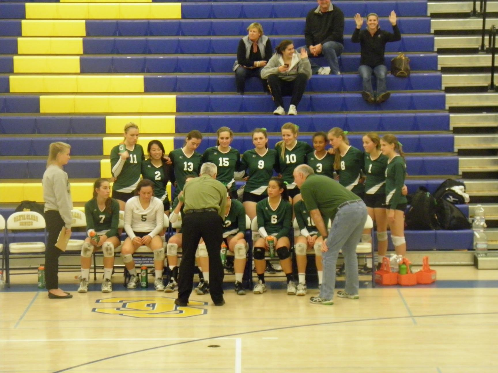 The Vikings gather during a time out called by Menlo Atherton in the third set.