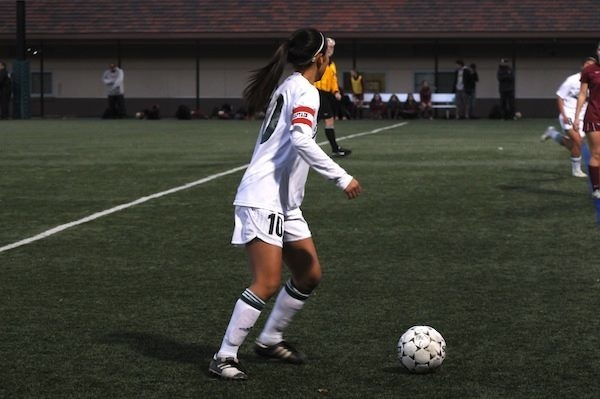Paly forward Sunny Lyu ('14) dribbles downfield in the Vikings' 2-1 loss against the Menlo-Atherton Bears at home.