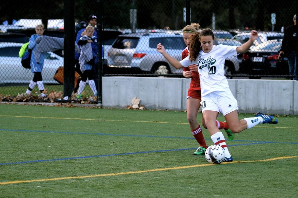 Megan Tall ('14) kicks the ball. The lady Vikes went on to defeat the 'Balers 2-0.