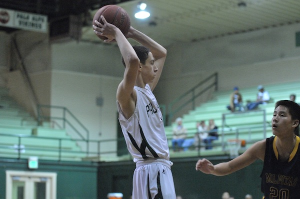 Team captain Noah Phillips ('14) looks to pass the ball. Phillips helped the Vikings defeat the Milpitas Trojans 66-56 on Friday night.