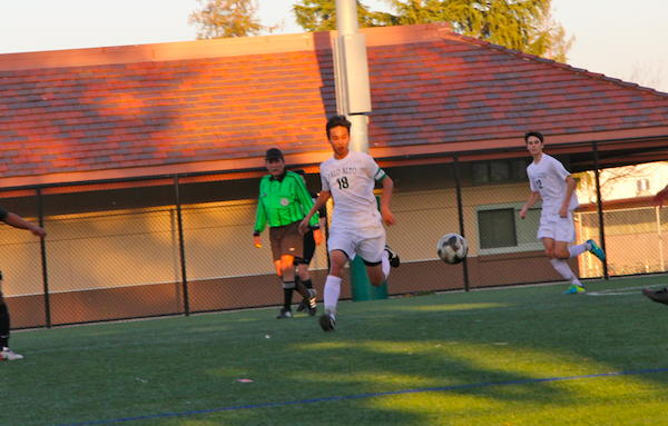 Wesley Woo ('15) follows the ball after a throw-in. Despite their long fought effort the Vikings fell to the Mountain View Spartan's 3-2.