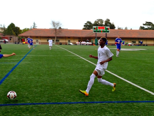 Dami Bolarinwa ('16) chases after the ball. The Vikings tied 1-1 against the Los Altos Eagles.
