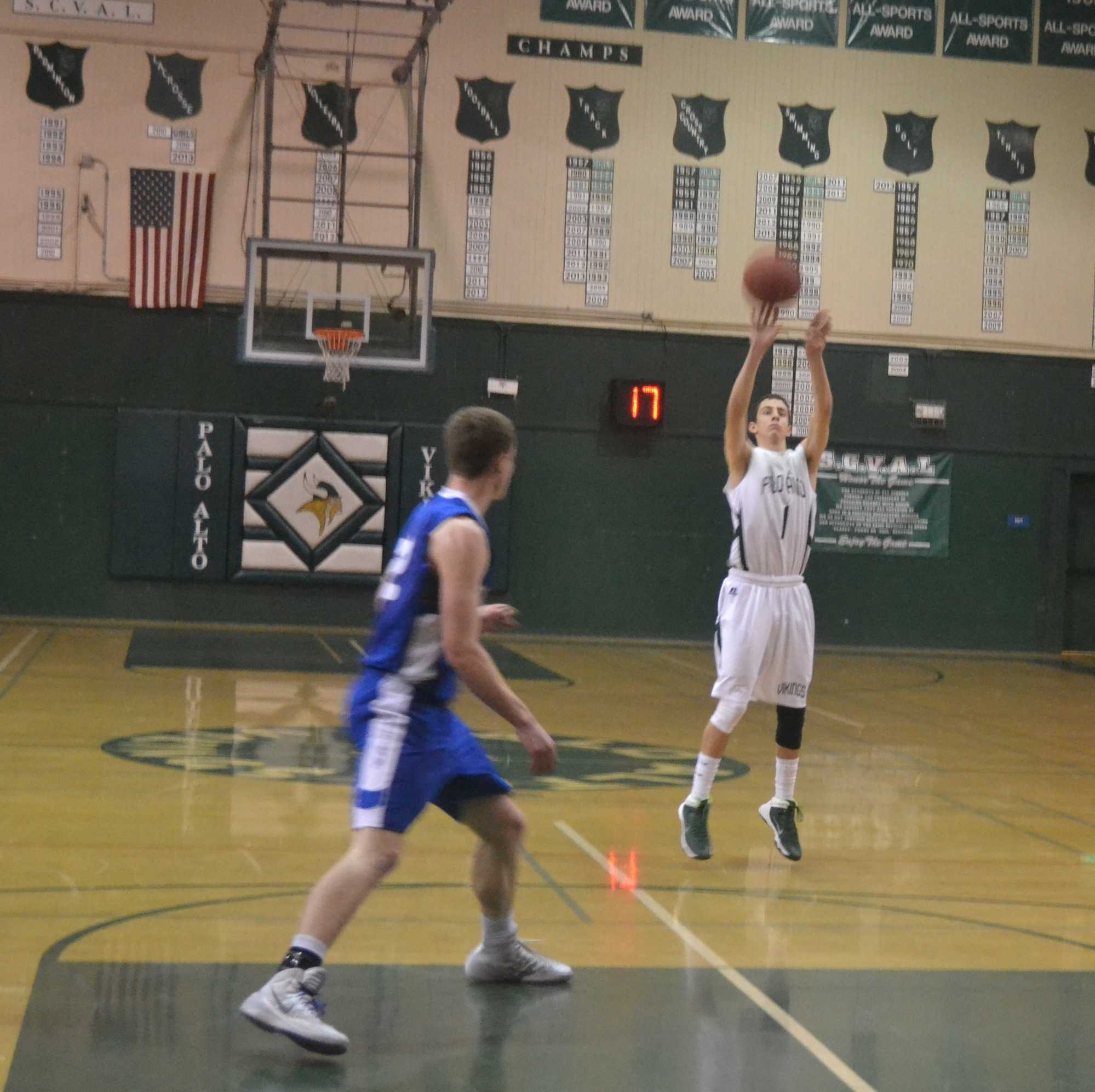 Noah Phillips ('14) shoots from the three-point line during Wednesday's basketball game against the Los Altos Eagles. The Vikings won the game 55-51.