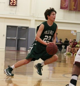 Kevin Mullin ('15) dribbles the ball towards the basket. Mullin was pulled up to the varsity basketball team last year by Coach Adam Sax.