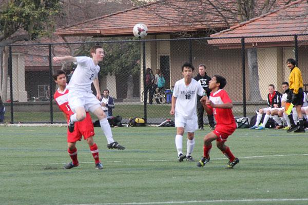 Jack Brooke ('15) goes up for a header against the Saratoga Falcons. The Vikings would go on to win 4-0.