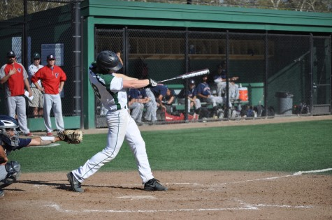Bowen Gerould ('14) hacks at a fastball in his first at bat. Gerould had 2 hits against Saratoga.