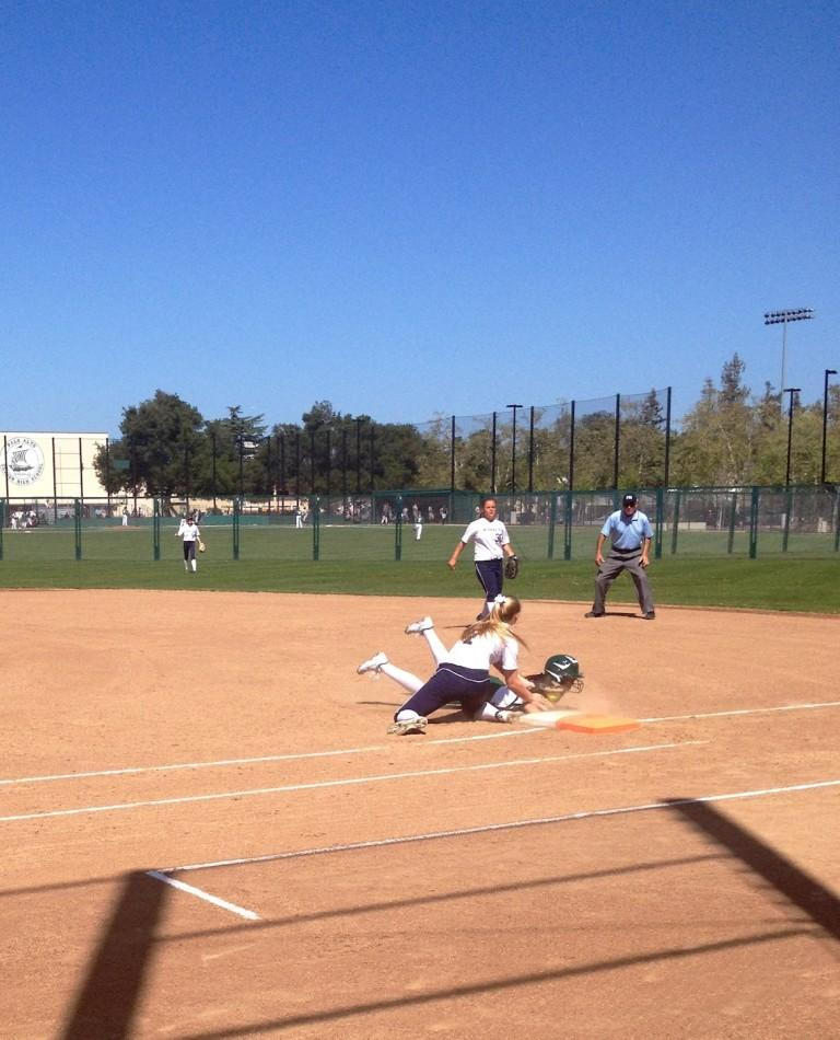 Casey Glassford ('15) tries to slide back to first, after attempting to steal second. She was out.