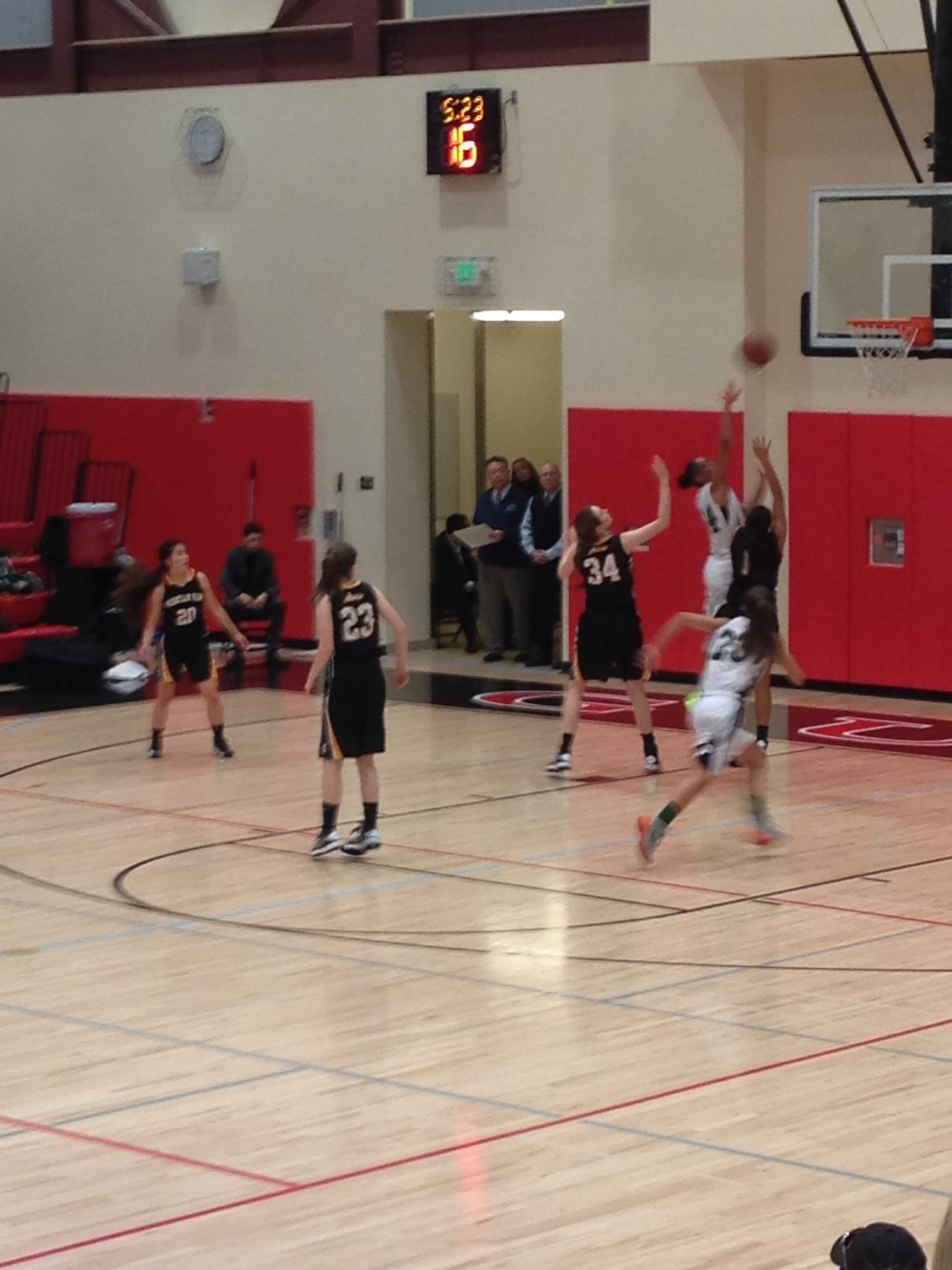 Alexis Harris goes up for a shot against two Mountain View defenders. Paly would go on to win 57-54.