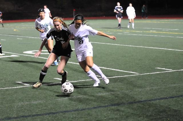 Alison+Lu+%28%2716%29+fights+for+possession+of+the+ball.+Lu+is+up+against+Los+Gatos+player+in+the+mid+field.+