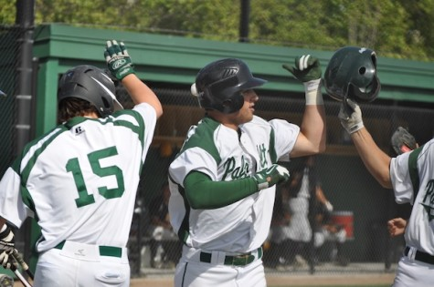 Jack Cleasby ('14) celebrates after hitting a home run in the first inning. The Vikings would go on to win 6-2.