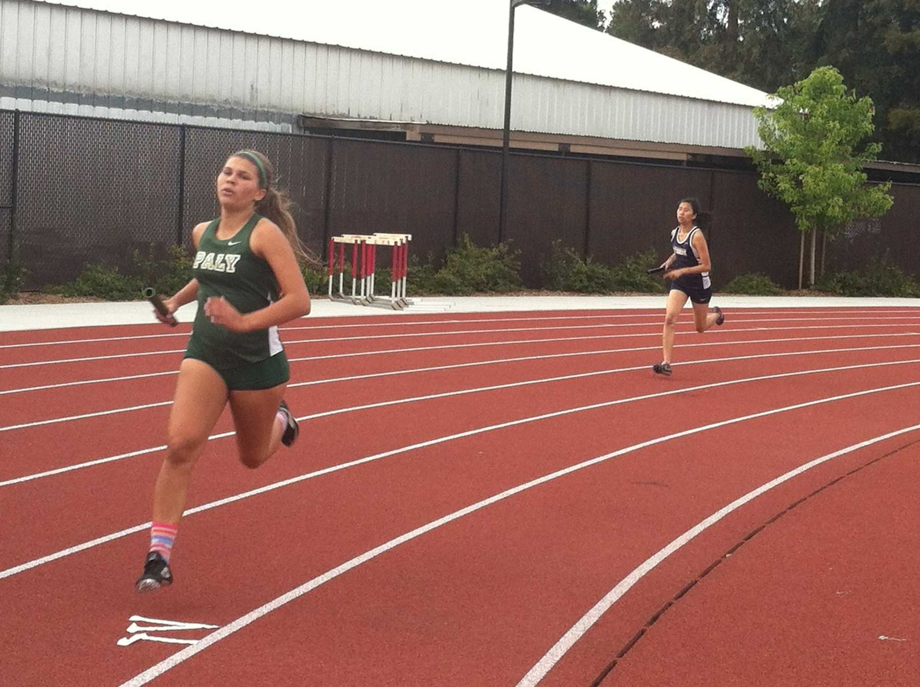 Jacey Pederson ('16) rounds a turn during the 4x400m relay. The Paly girls cruised to victory while taking first in 13 of 15 events.