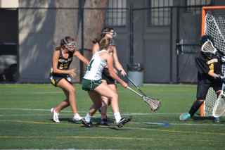 Allie Peery ('15) finishes a goal against two Mountain View defenders. Peery had six goals in the game.