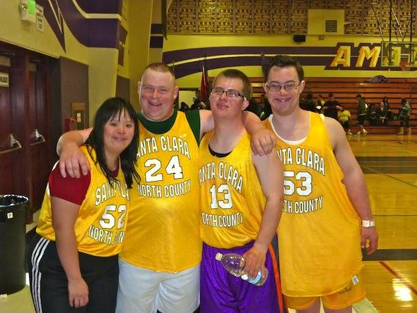 Champ Pederson ('06) poses with members of his basketball team. Pederson has participated in the Special Olympics of Northern California.