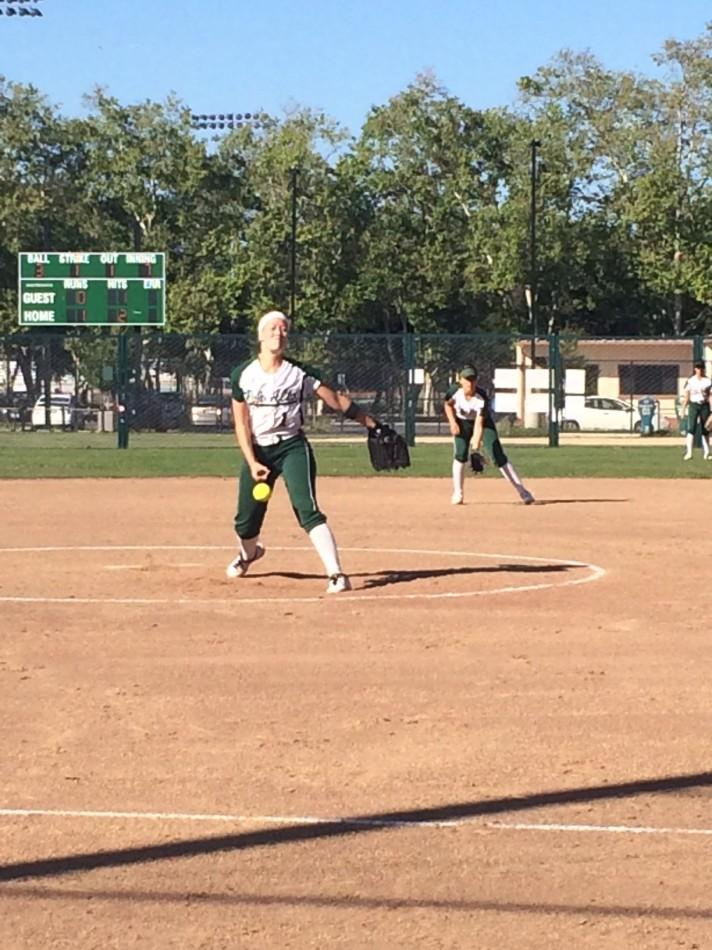 Julia Saul ('14) throws a pitch in the seventh inning. She had 10 strikeouts in the game.