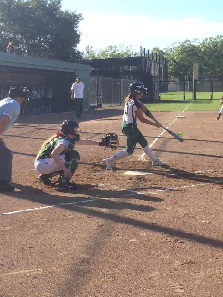 Hannah Bundy ('14) hits a single in the sixth inning. Later in the inning, Bundy scored.