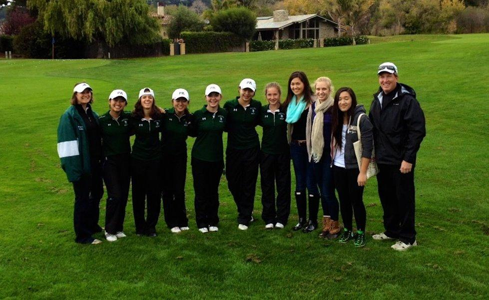 The 2013-2014 Girls' Golf team poses with Coach Doyle Knight.