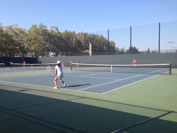 Mailinh Truong ('18) gets ready to return her opponent's serve in the match against Castilleja on Wednesday.