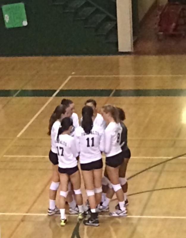 The starters talk to each other before the start of the first set against Monta Vista. The Vikings would go on to win the first set 27-25.