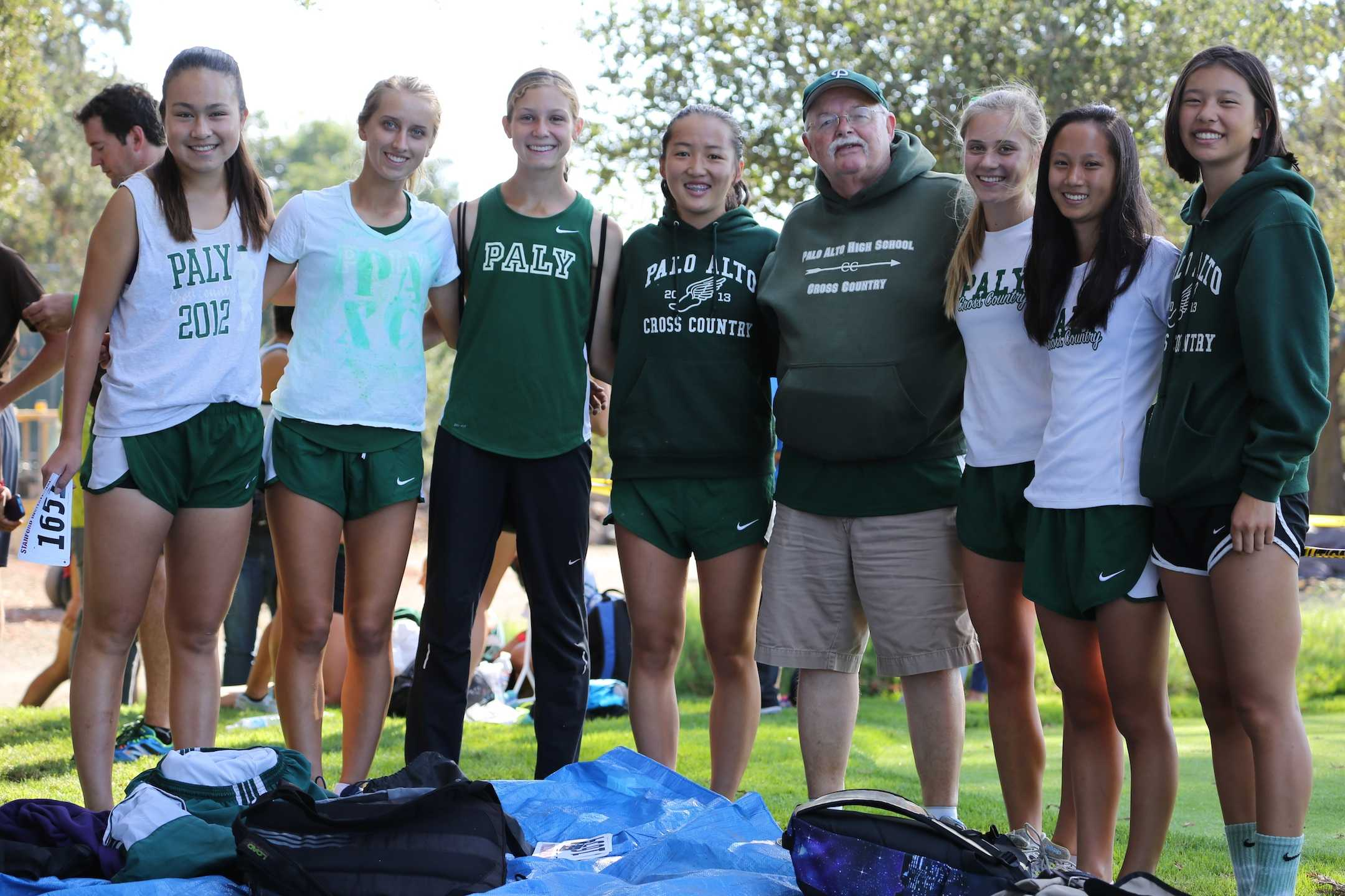 Runners on the girls' varsity cross country team pose with coach Paul Jones. There are 52 athletes on the roster and many of them have a passion for running.