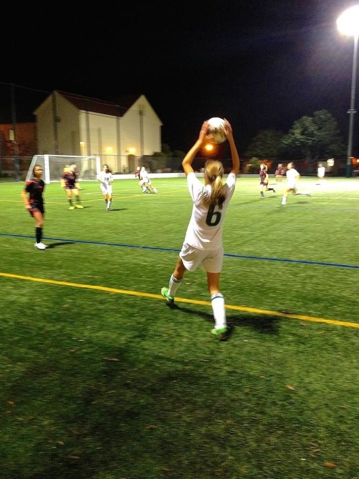Bella Bonomi ('18) prepares to do a throw-in during the second half of the game. The Vikings went on to win 1-0 against Burlingame.