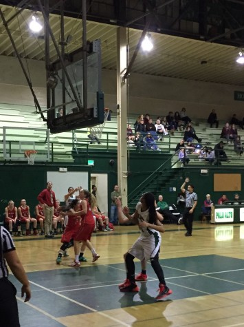 Alexis Harris ('17) boxes out a Saratoga defender in hopes of an offensive rebound. Harris had 11 points, three boards, and five blocks in the game.