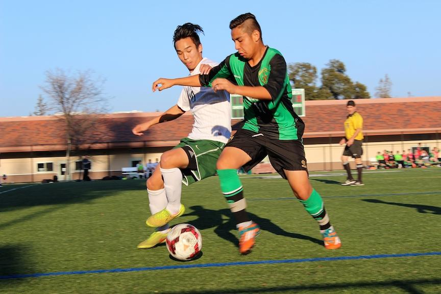 Wesley Woo ('15) goes for a 50-50 ball against a Homestead Mustang player. The Vikings went on to win 1-0.