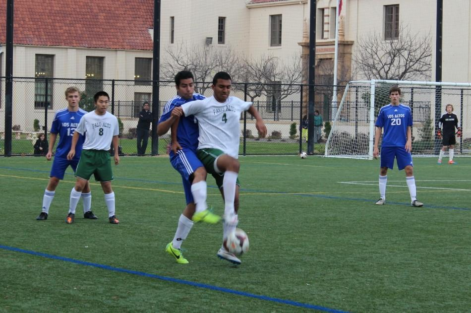 Sid Srinivasan ('16) defends the ball from a Los Altos player as he attempts to turn it and move it forward. The Vikings went on to win 1-0.