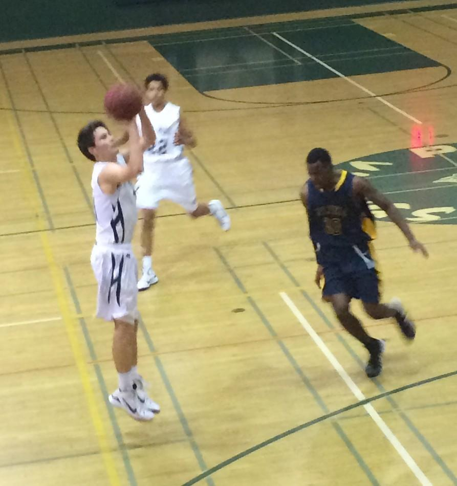 Kevin Mullin ('15) shoots a three-pointer against Milpitas in the third league game of the season.
