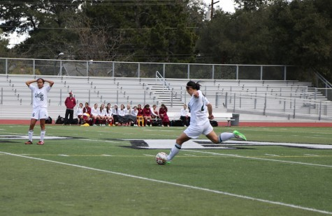 Alison Lu ('16) takes a free kick at midfield. Paly's strong defense held Menlo-Atherton scoreless.