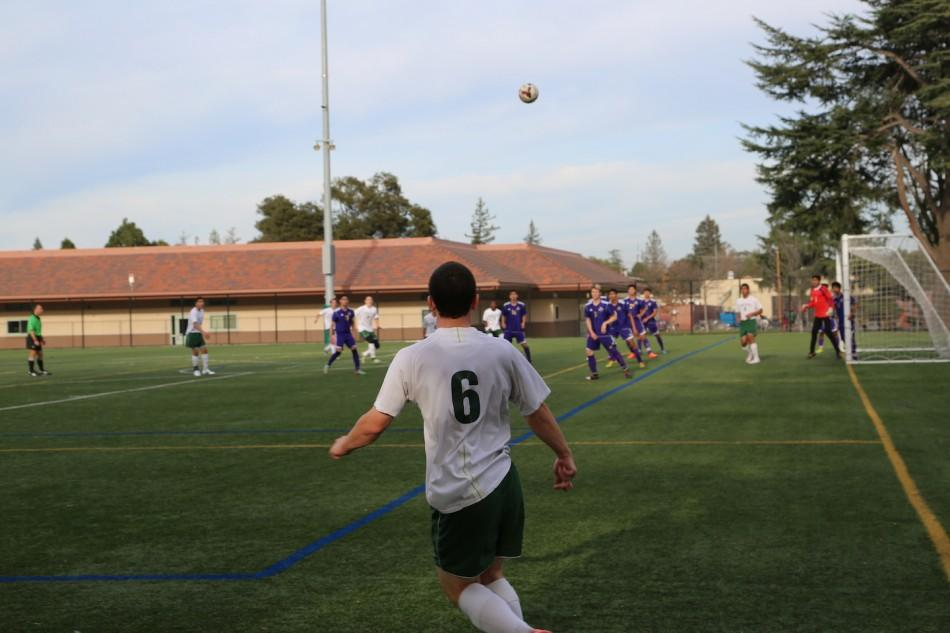 Captain Preston Kuppe ('15) looks on as his corner kick flies through the air. The Vikings went on to lose to Monta Vista 1-0.