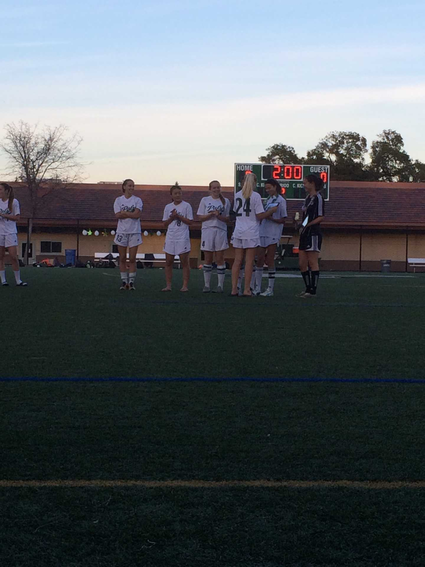 Paly's six seniors are honored in a ceremony following their 8-0 win over Homestead. Senior night marked the final home game of league play.
